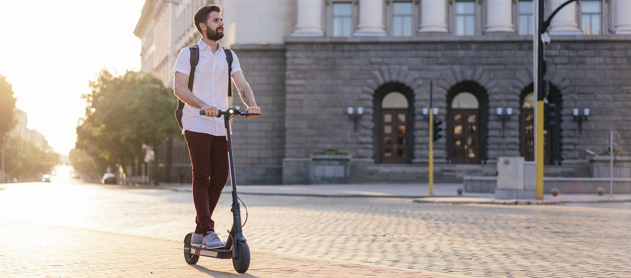 Image of a man on an electric scooter