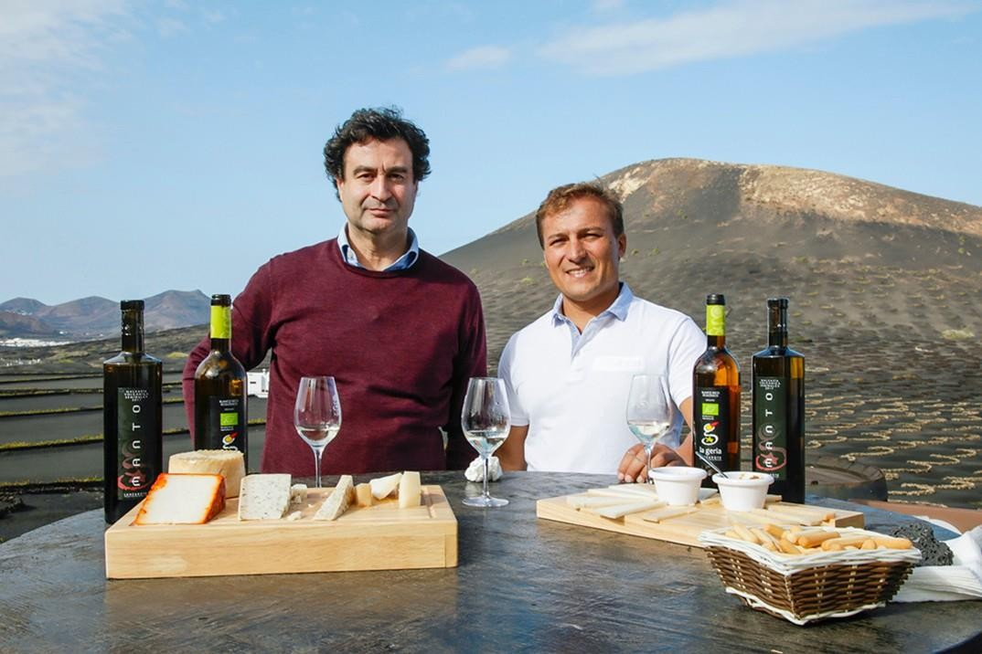 Germán and Pepe enjoying a local tasting session of wines, cheeses and marmalades